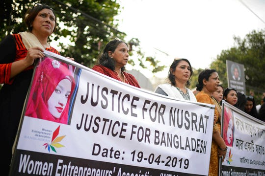 In this Friday, April 19, 2019, file photo, protesters gather to demand justice for an 18-year-old woman Nusrat Jahan Rafi who was killed after she was set on fire for refusing to drop sexual harassment charges against her Islamic school's principal, in Dhaka, Bangladesh.