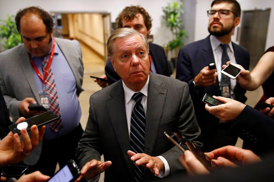 Sen. Lindsey Graham, R-S.C., speaks with members of the media, Tuesday, Oct. 22, 2019, on Capitol Hill in Washington.