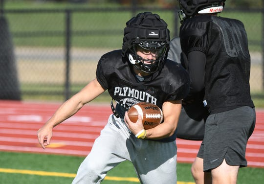 Plymouth's Mike Mathias runs plays during practice Wednesday.