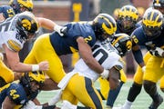 Michigan's defense, which includes defensive lineman Carlo Kemp (2), ranks No. 14 in the nation in total defense.