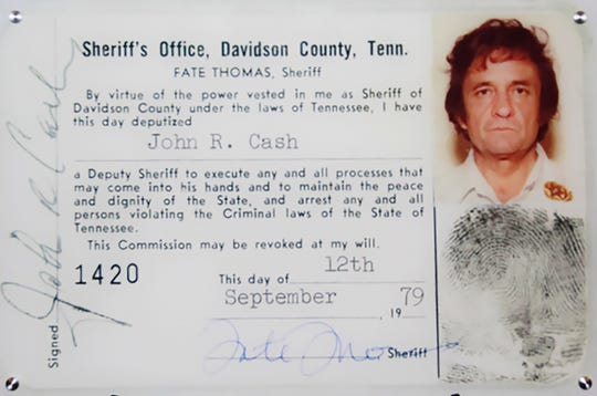 This 1979 image released by the Davidson County (Tenn.) Sheriff's Office via the Johnny Cash Museum, shows Cash's Deputy Sheriff ID card.