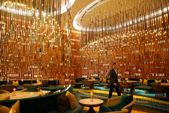 A person walks through a lounge at the Seminole Hard Rock Hotel and Casino.