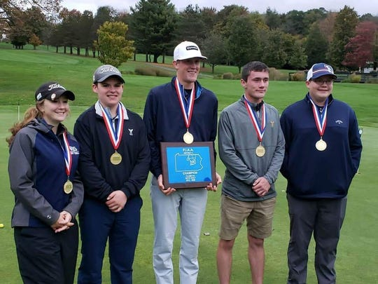 From left, Cowanesque Valley golfers Skylar Smith, Joel Heck, Austin Outman, Josh Whalen and Zach Carr pose with the District 4 Class AA championship plaque at Eagles Mere Country Club on Oct. 4.