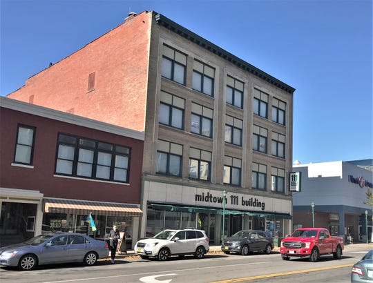 Ithaca developer Seth Adams is the new owner of the historic 111 Midtown Building in downtown Elmira. To the left is the former Werdenberg building, which Adams also owns.