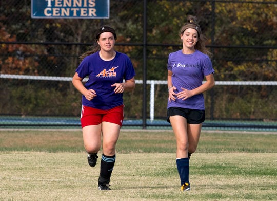 Sisters Sierra, left, and Lauren Goebel, right, run around the field during practice at Evansville Day School Wednesday evening, Oct. 23, 2019. The Goebel's are two of the quadruplets that play soccer for Evansville Day School who recently won the first regional title in program history.