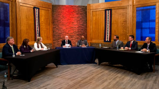 At-large City Council candidates address questions during a debate held in the WINN studio Thursday morning, Oct. 24, 2019.