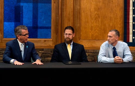 Mayoral candidates incumbent Mayor Lloyd Winnecke (R), left, Steve Ary (I), middle, and Bart Gadau (L), right, address questions during a debate held in the WINN studio Thursday afternoon, Oct. 24, 2019.