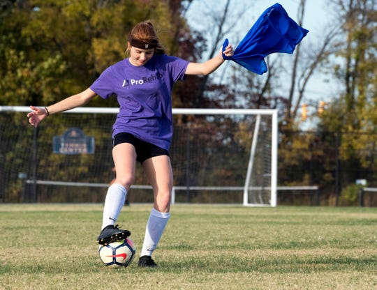 Danielle Goebel passes the ball during practice at Evansville Day School Wednesday evening, Oct. 23, 2019. The Goebel's are quadruplets that play soccer for Evansville Day School who recently won the first regional title in program history.