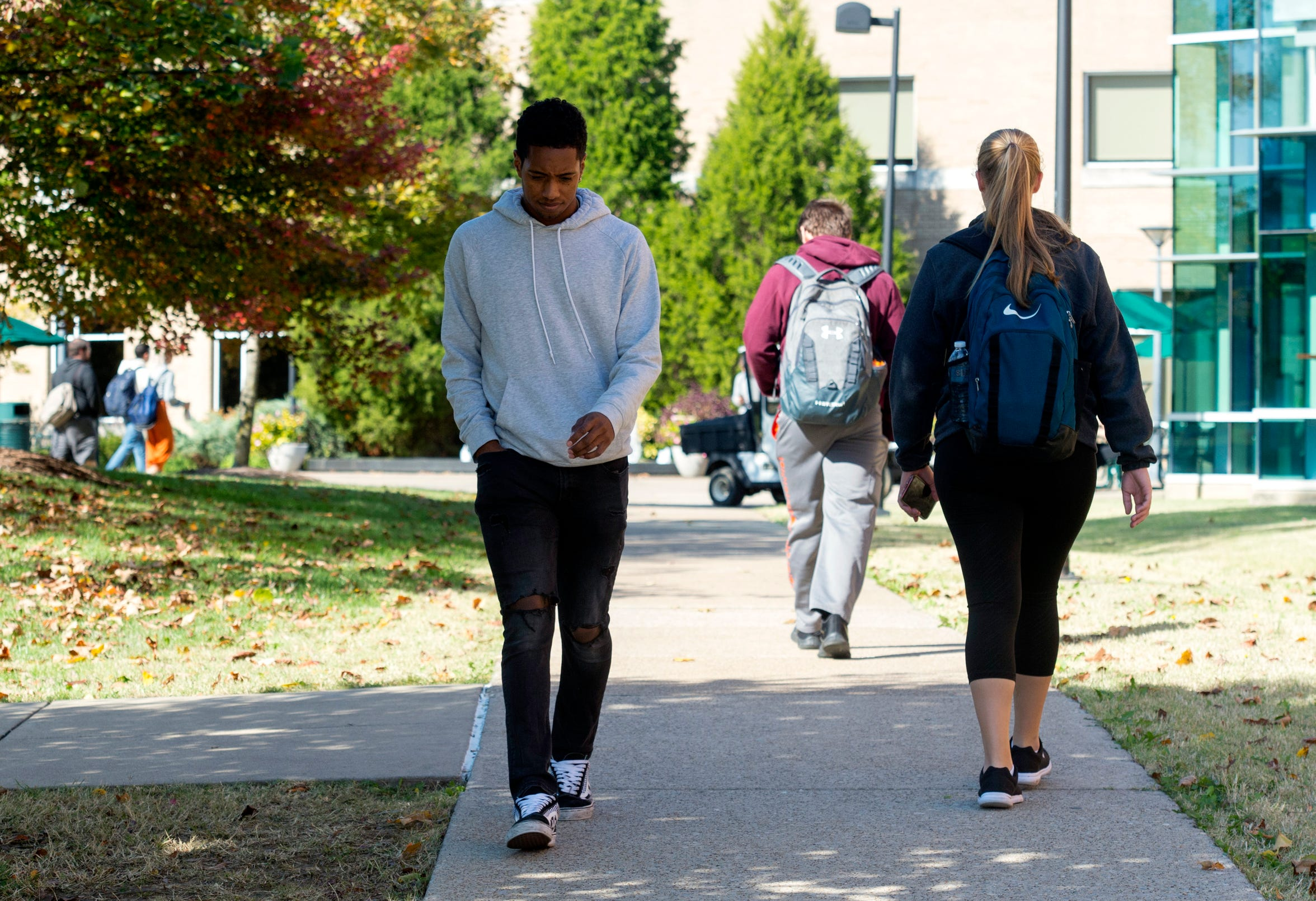University of Southern Indiana Cross Country runner Darin Lawrence walks towards the PAC on campus Tuesday afternoon, Oct. 23, 2019.
