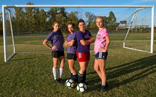 The Goebel quadruplets, from left, Danielle, Lauren, Sierra and Cassidy. The sisters are senior soccer players for Evansville Day School who just one their first regional title in program history.