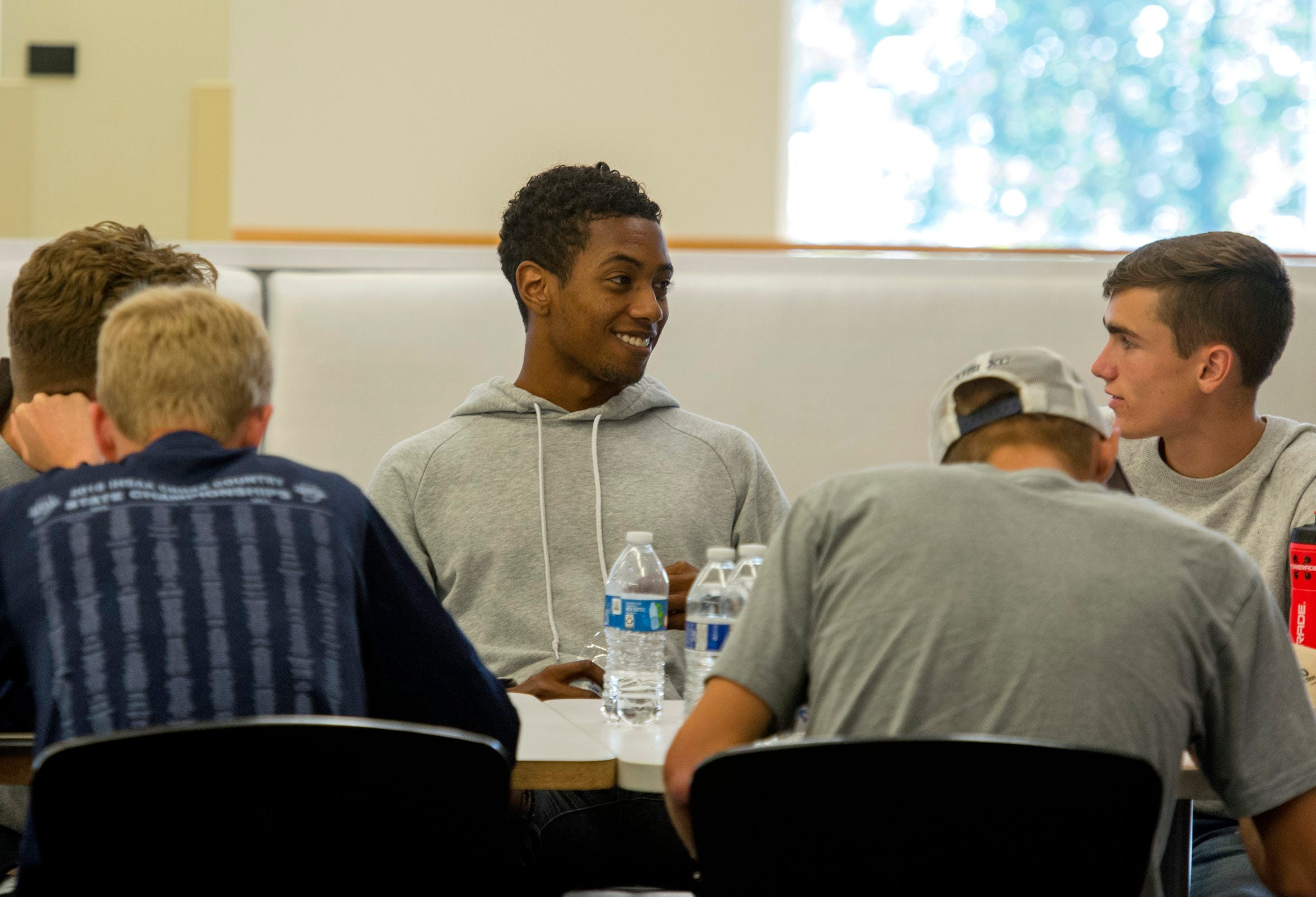 University of Southern Indiana Cross Country runner Darin Lawrence eats lunch with his teammates in the Loft on USI's campus Tuesday afternoon, Oct. 23, 2019.