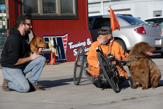 Brandon Hau, with his dog Brewtis, talk with Floyd Freiberg, with his dog OJ, Wednesday, October 23, 2019 in Fond du Lac, Wis. Brandon saved Floyd's life on Oct. 8 when he lifted him and his  modified bike off railroad tracks on Scott Street in Fond du Lac seconds before a train crossed the intersection.  Doug Raflik/USA TODAY NETWORK-Wisconsin
