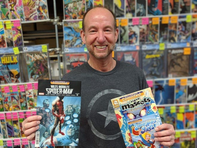 Chris Rupp of Rupp's Comics shows some of the selection of free comics to be offered for free Saturday during Halloween ComicFest.