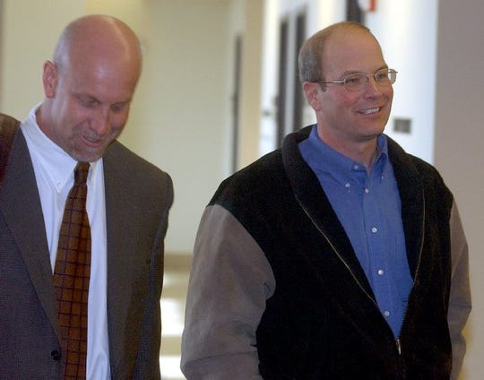 Tim Evans, right, and his lawyer, Erik Fischer, left, walk out a preliminary court hearing at the Larimer County Justice Center in January 2006.