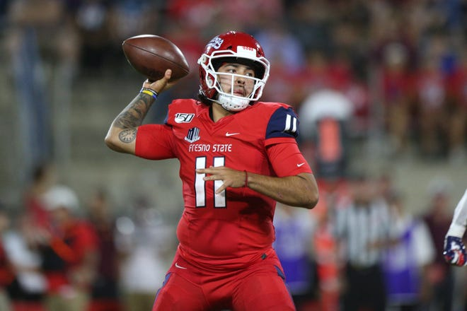 Fresno State Bulldogs quarterback Jorge Reyna (11) throws a pass against the Minnesota Golden Gophers in the first quarter at Bulldog Stadium.