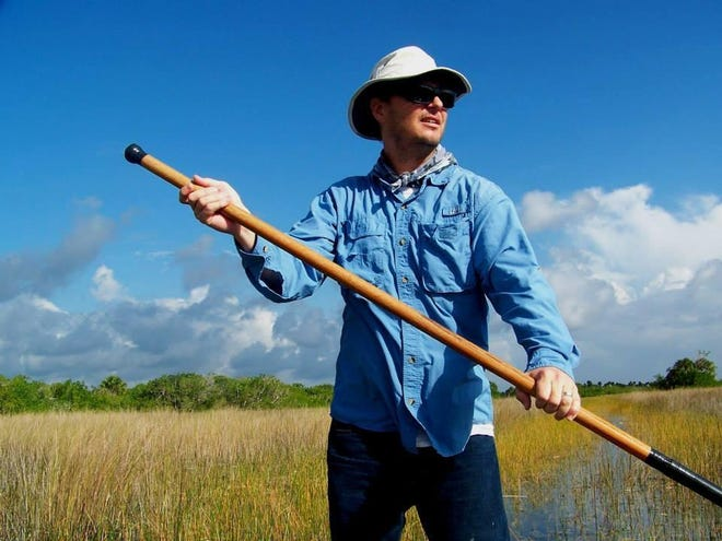 Chad Gillis poles a canoe in the historic Everglades. Gillis has been an environmental journalist in Southwest Florida since 1999. MARCIE GILLIS/FILE