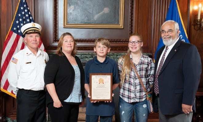 Town of Riverview Fire Chief TJ Shrank, left, received the Assembly First Responder Award for the 36th District during a floor session on Oct. 10. With his is his wife Brenda, son Cody, daughter Jessie, and Rep. Jeff Mursau, who represents the district.