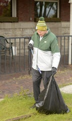 Mark Murphy, president and CEO of the Green Bay Packers, picks up trash in the Broadway district on Oct. 24, 2019.