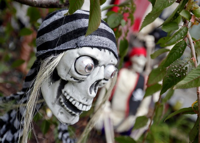 Arrr! Pirates are a favorite of Richard and Denise Parsley's Halloween display. That just may be them dressed as a pirate and his lady greeting trick-or-treaters at their home on Halloween.