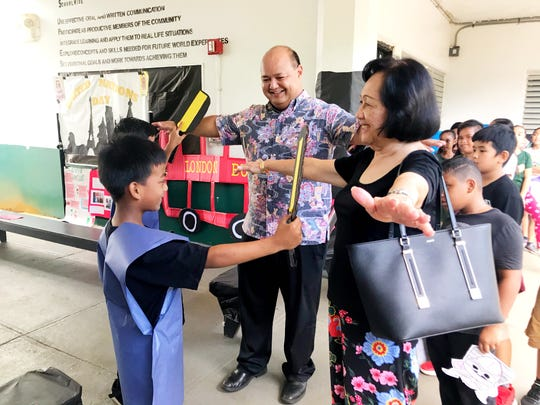 GDOE Superintendent Jon Fernandez and Vice Chair Maria A. Gutierrez among the guests that attended Upi Elementary School's United Nations Day on October 24, 2019.