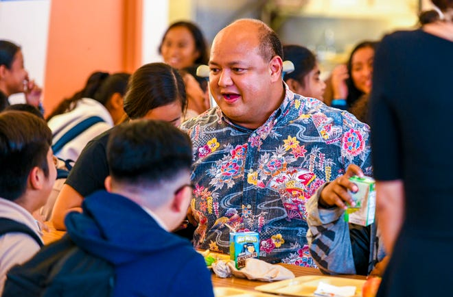 Guam Department of Education Superintendent Jon Fernandez chats with students during a Lunch with a Cop activity at Luis P. Untalan Middle School on Thursday, Oct. 24, 2019.
