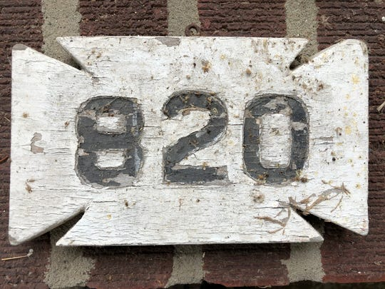 Aged and weathered, this custom-made house street number sign is one of a number that still hang from homes in older Henderson neighborhoods. But who made and sold them, and when?