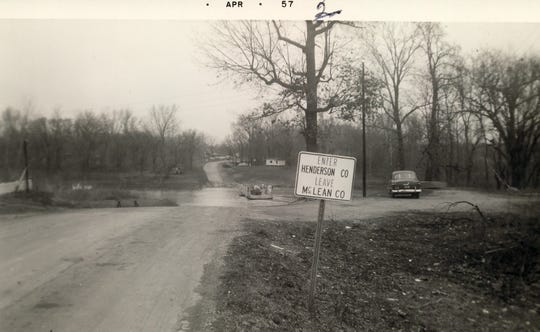 The Ranger's Landing Ferry on Kentucky 136 into McLean County, depicted here in April 1957, was the last ferry operation in Henderson County. It made its final trip Sept. 25, 1970. O.B. Kirtley, the operator, had charged 75 cents for each car and $1 for each truck crossing the Green River. (Photo courtesy Johnny Williams)