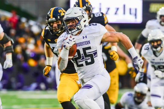 Isaiah Bowser (25) raced 34 yards for a third-quarter touchdown against Iowa that changed the course of the game in a 14-10 Northwestern win at Kinnick Stadium.