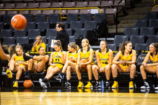 Iowa players hang out on the bench during Hawkeyes women's basketball media day, Thursday, Oct., 24, 2019, at Carver-Hawkeye Arena in Iowa City, Iowa.