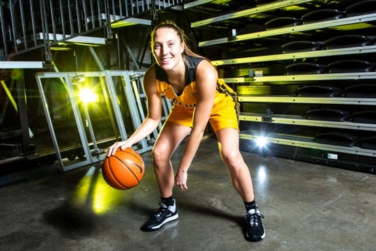 Iowa center Amanda Ollinger (43) poses for a photo during Hawkeyes women's basketball media day, Thursday, Oct., 24, 2019, at Carver-Hawkeye Arena in Iowa City, Iowa.
