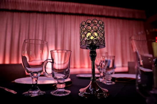A table is set at Stage to Screen Catered Cabaret Theatre in Greenwood, Thursday, Oct. 24, 2019.  The theatre is getting ready for its grand opening in a larger venue.