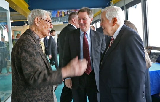 P.E. MacAllister (left) talks with Mayor Joe Hogsett and Sen. Richard Lugar in the City-County Building in 2017.
