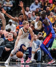 Indiana Pacers forward Domantas Sabonis (11) pushes past Detroit Pistons forward Thon Maker (7) during the second half at Bankers Life Fieldhouse, Wednesday, Oct. 23, 2019, Indianapolis. The Pistons defeated the Pacers at the their home opener, 119-110.