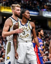 Indiana Pacers forward Domantas Sabonis (11) talks to Indiana Pacers guard Edmond Sumner (5) after a foul during the second half at Bankers Life Fieldhouse, Wednesday, Oct. 23, 2019, Indianapolis. The Pistons defeated the Pacers at the their home opener, 119-110.