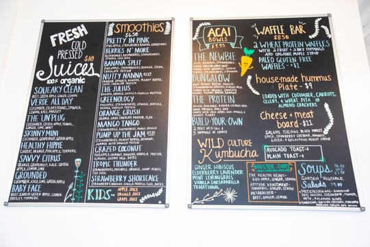 A menu board is pictured, Wednesday, Oct., 23, 2019, at Smash Juice Bar in North Liberty, Iowa.