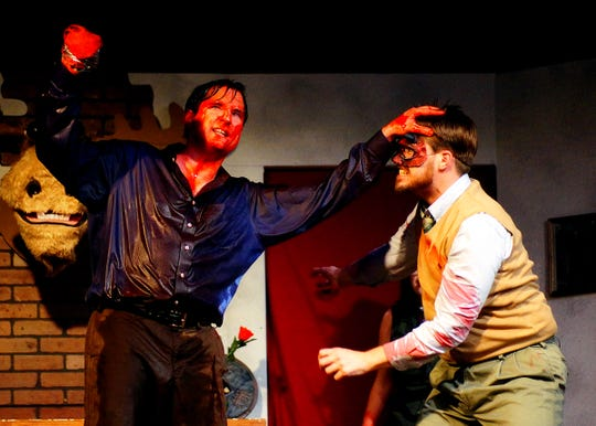 """The cast of Iowa City Community Theatre's production of """"Evil Dead: The Musical"""" perform during the Oct. 23 dress rehearsal. Pictured is main character Ash, played by Rob Merritt, in combat with the undead."""