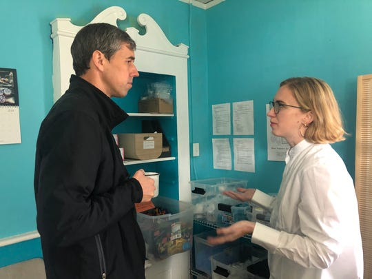 Democratic presidential candidate Beto O'Rourke listens to Iowa Harm Reduction Coalition director Sarah Ziegenhorn at coalition office Oct. 24, 2019 in Cedar Rapids.