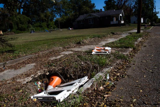 Sidewalks on Airway Boulevard  is seen with divots and trash of Jackson's streets.