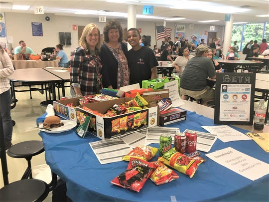 "Beta Club sells snacks to raise funds. Shown are Beta Club sponsors, seventh grade English Language Arts teacher Lisa Ogle and sixth grade social studies teacher Ginger Cook, and Beta Club member, seventh grader Xavier Hodge. Why is he in Beta Club? ""I just want to help people,"" says Hodge."