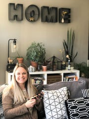 Wallis Woodward, Hoops and Hollers Embroidery, works on one of her designs in her South Knoxville home on Oct. 24, 2019.