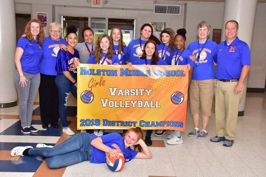 The Holston Middle School varsity volleyball team was recently crowned 2019 District Champions. Pictured are: (front) Reagan Bull; (middle) Alyssa Blakely, Macie Wolfe, Alexis Mitchell; (back) principal Kathryn Lutton, coach Judy Pickering, Avion Rickman, Kylee Forrester, Addison Luna, Emily Ryan, Kyla Chesney, coach Janet Ross and assistant principal Jim Wolfenbarger.