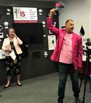 Raising money for the American Cancer Society, His Security co-owner Scott Brockamp auctioned a hat during a recent networking event.  FWKCC President Julie Blaylock assisted his efforts.