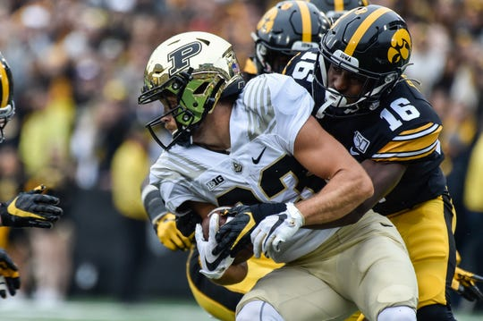 Oct 19, 2019; Iowa City, IA, USA; Purdue Boilermakers wide receiver Jackson Anthrop (33) is tackled by Iowa Hawkeyes defensive back Terry Roberts (16) during the second quarter at Kinnick Stadium. Mandatory Credit: Jeffrey Becker-USA TODAY Sports