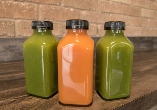 Juices that will be offered at The Simply Fresh Cafe at the 2|42 Community Center include Exhale (in the center), which relaxes muscles, and Maintain, which is rich in vitamins and minerals, shown at church 2|42 Community Church in Genoa Township Thursday, Oct. 24, 2019.