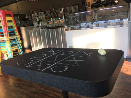 When Blank Slate Creamery opens in downtown Brighton next year, it will feature chalkboard tables and walls, like this one, shown Thursday, Oct. 24, 2019 at their Ann Arbor location.