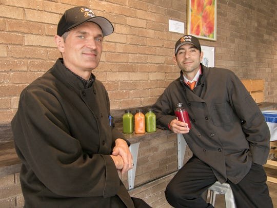 With plans to take over operation of the cafe at 2 42 Community Church, Shaun Himmelspach, The Simply Fresh Cafe director of operations, and Simply Fresh Market co-owner Tony Gelardi display some cold-pressed raw juice offerings Thursday, Oct. 24, 2019.