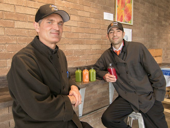 With plans to take over operation of the cafe at 2|42 Community Church, Shaun Himmelspach, The Simply Fresh Cafe director of operations, and Simply Fresh Market co-owner Tony Gelardi display some cold-pressed raw juice offerings Thursday, Oct. 24, 2019.