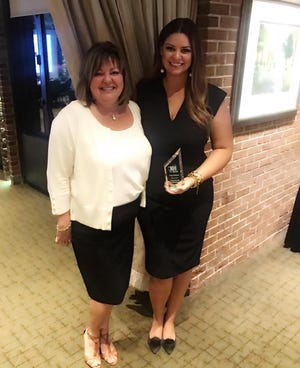 """Jackson being a recipient of the Lansing Regional Chamber's 13th annual """"10 Over the Next Ten"""" awards, which recognize """"young professionals who are expected to contribute significantly to our community over the next ten years."""""""