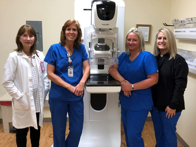 Members of the radiology department stand with the new 3-D mammography machine at Avita Health System Ontario Hospital. From left are Melody Joice, Kristi Fox, Amber Skelton and Jenny Niese.