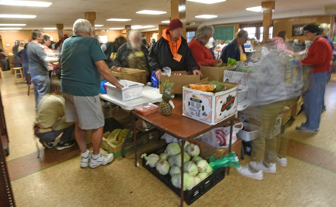 The fast action of the Grace Episcopal food pantry every Thursday morning.